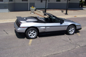 Fiero convertible at depot