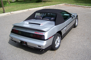 Fiero convertible at a park